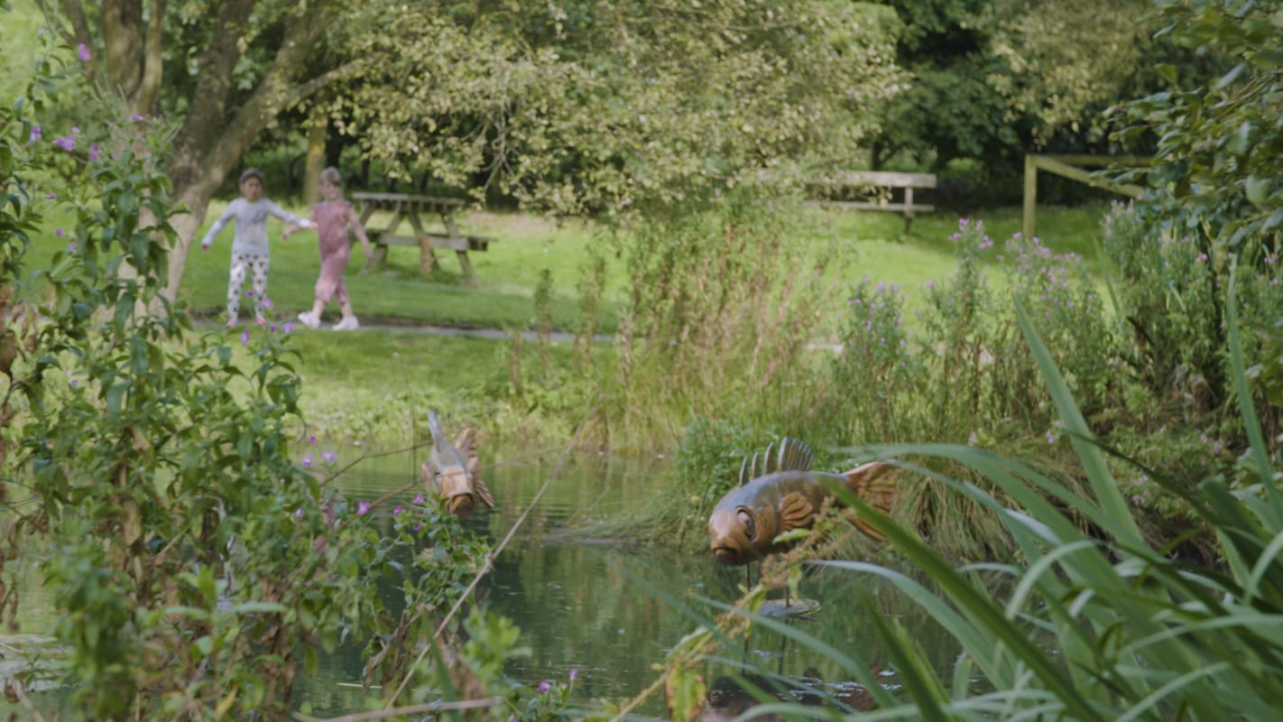 Photograph of fish sculptures at a lake in Guisborough Forest and Walkway